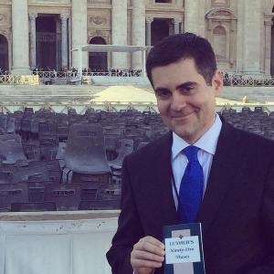 Russell Moore Having Fun at the Vatican.   (Holding a copy of Luther's Ninety-Five Theses